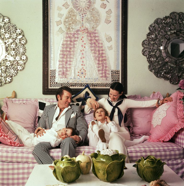 family-portrait-of-the-coopers-as-they-play-on-a-sofa-in-news-photo-50992613-1560804807.jpg