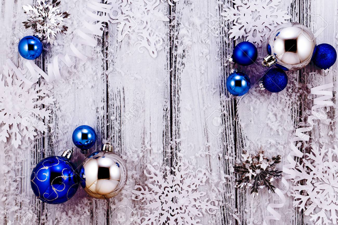 48771282-new-year-theme-christmas-tree-white-and-silver-decorations-blue-balls-snow-snowflakes-serpentine-on-.jpg