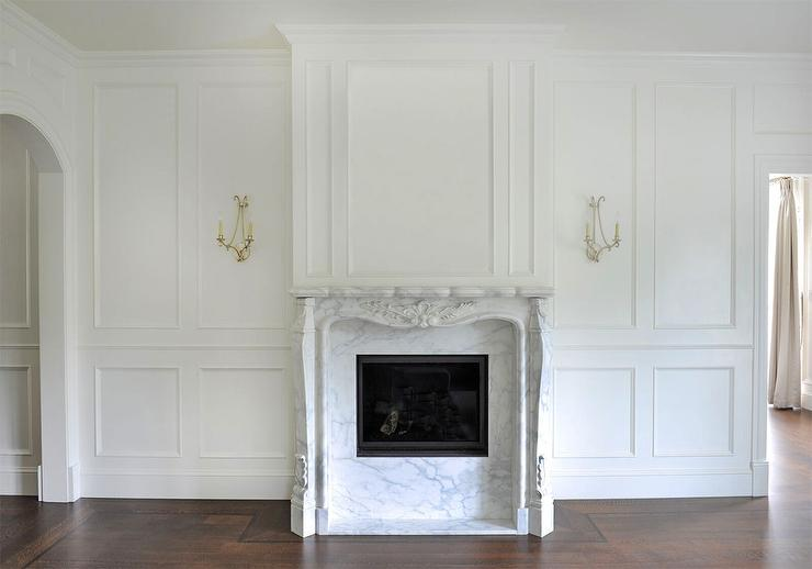 french-antique-brass-sconces-with-french-marble-fireplace
