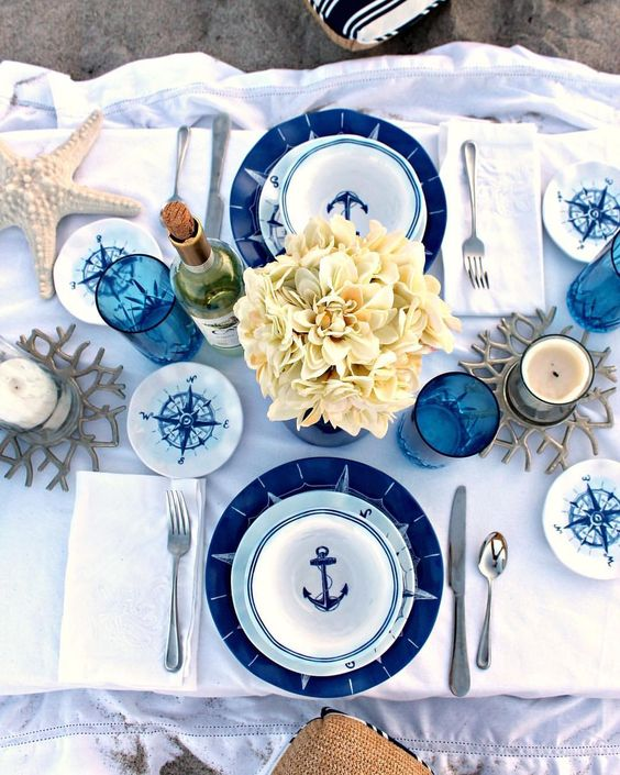 bba-gorgeous-nautical-shower-tablescape-with-navy-and-blue-plates-neutral-blooms-compasses-starfish-and-blue-glasses