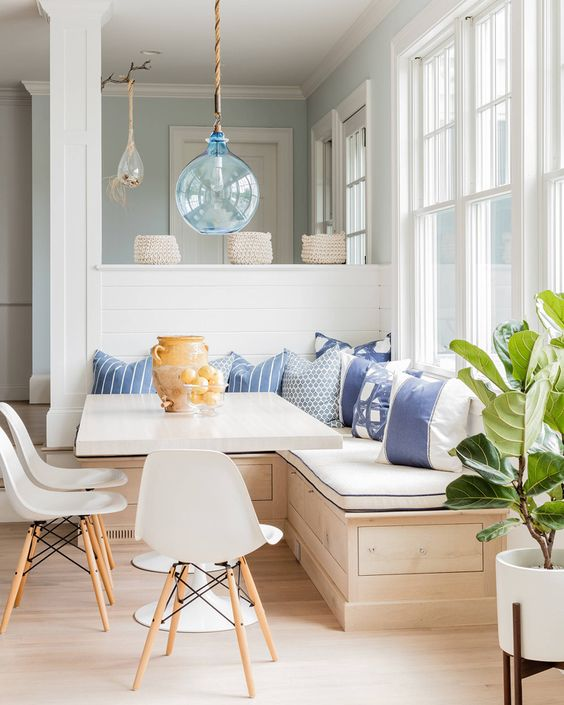 13-a-wooden-corner-bench-with-storage-space-and-lots-of-pillows-for-a-cozy-breakfast-nook
