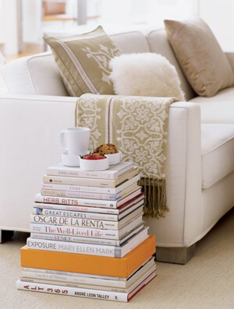 Decorating-wtih-Coffee-Table-books-large-stacks-of-books-using-books-for-a-side-table-or-coffee-table-stacked-books-against-a-wall-2