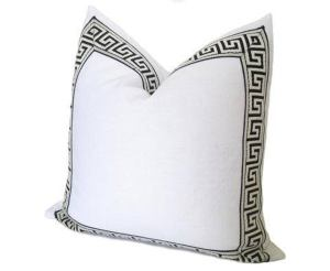 white decorative pillow with greek key trims