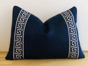 blue decorative pillow with greek key trims