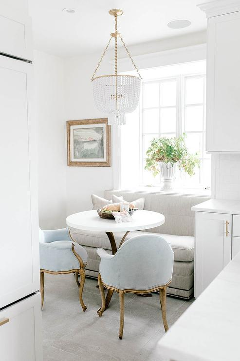 light-gray-dining-settee-with-small-round-bistro-table