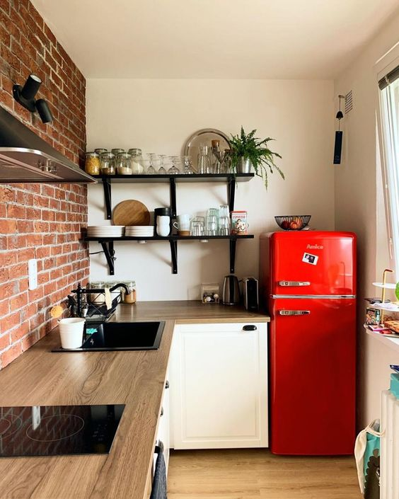 15-a-bright-red-fridge-brings-color-to-the-space-and-makes-it-fun-bright-and-welcoming