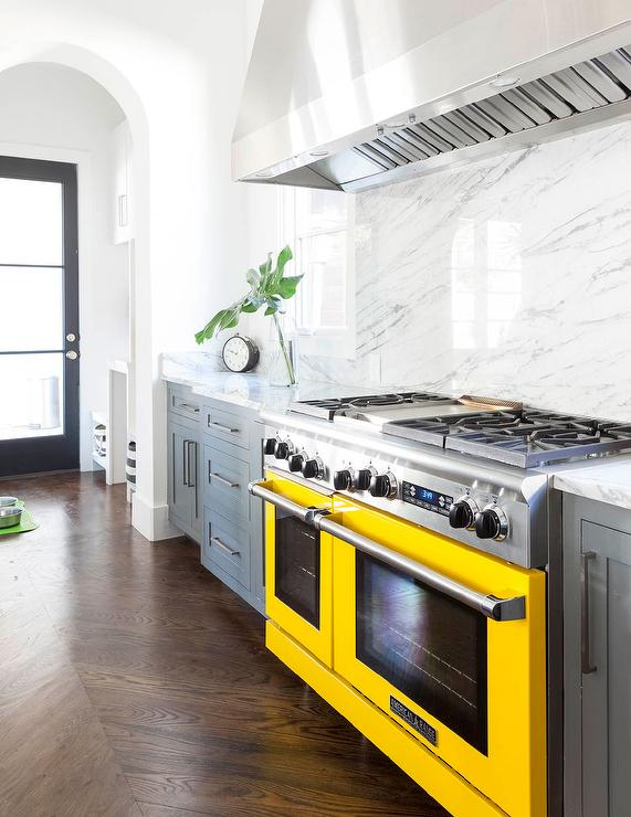 gray-kitchen-cabinets-yellow-stove
