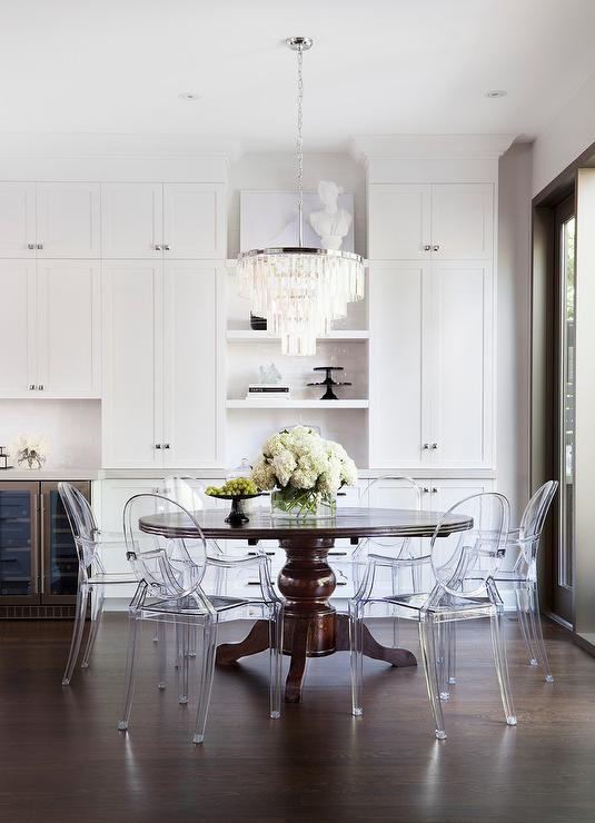 lucite dinng chairs with classical table