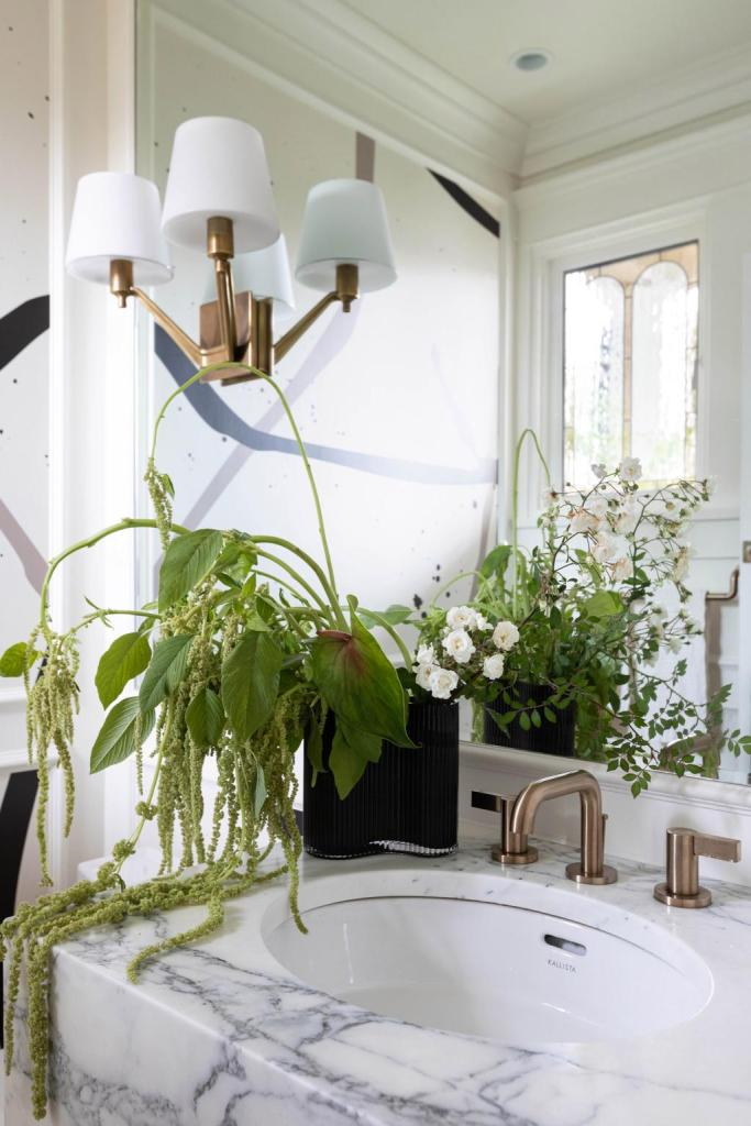 a small airy and bright powder room with big style