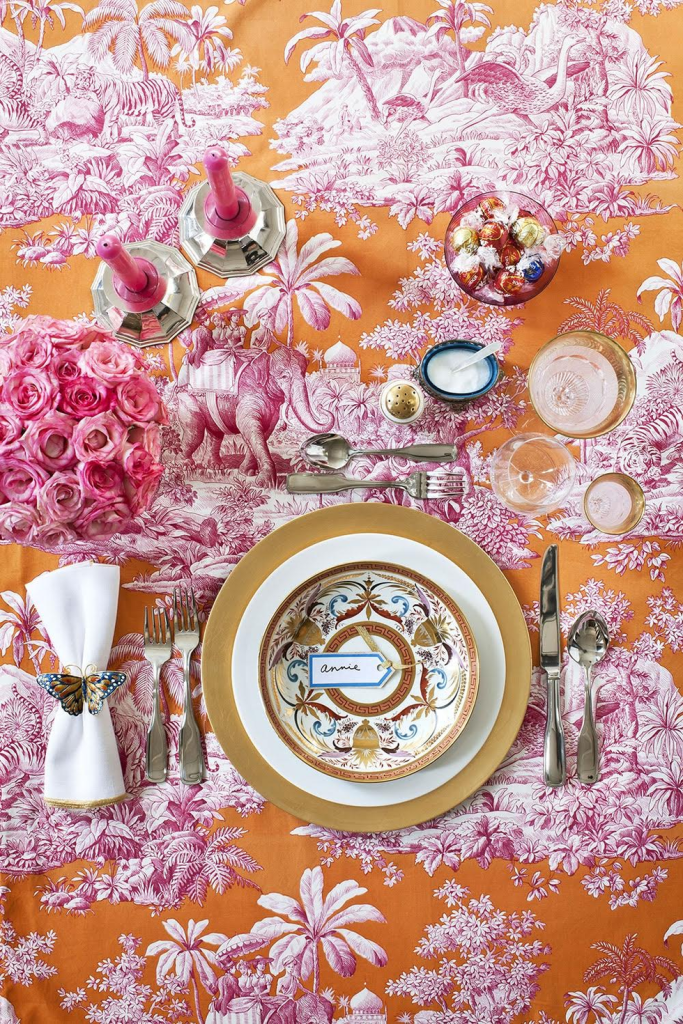 elegant outdoor tablescape with orange tablecloth