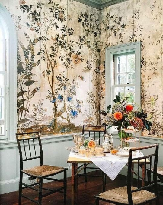 muted yellow floral-and-bird murals