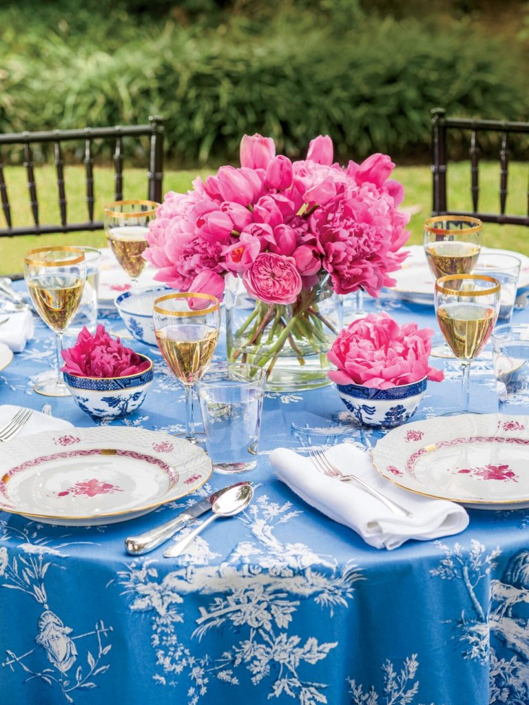 elegant outdoor tablescape with blue tablecloth