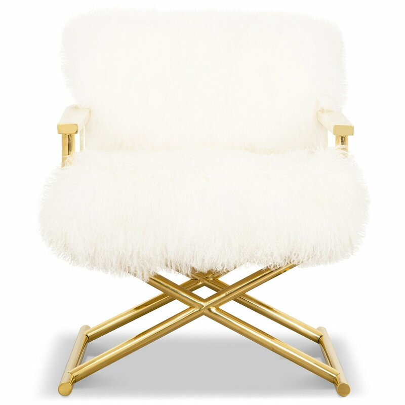 white fur chair with brass frame