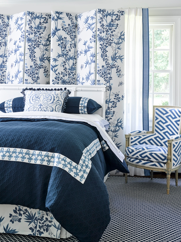 blue chinoiserie screen in a classic bedroom