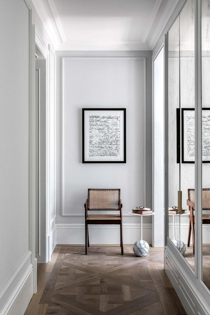 The vignette of a wicker chair and a minimalism accent marble table at this corner