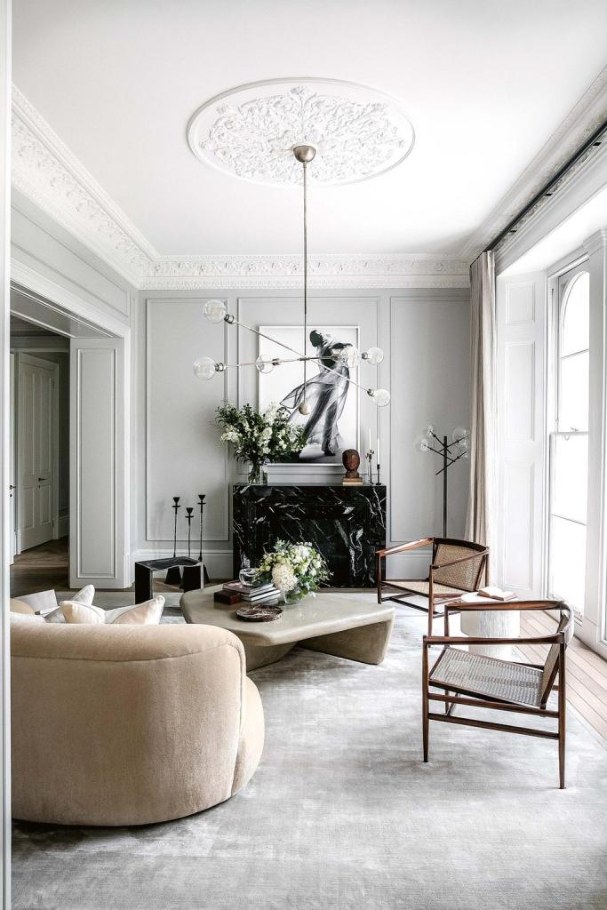 a living room with  soft color palette of grey and white, punctuated with a dose of muted peach