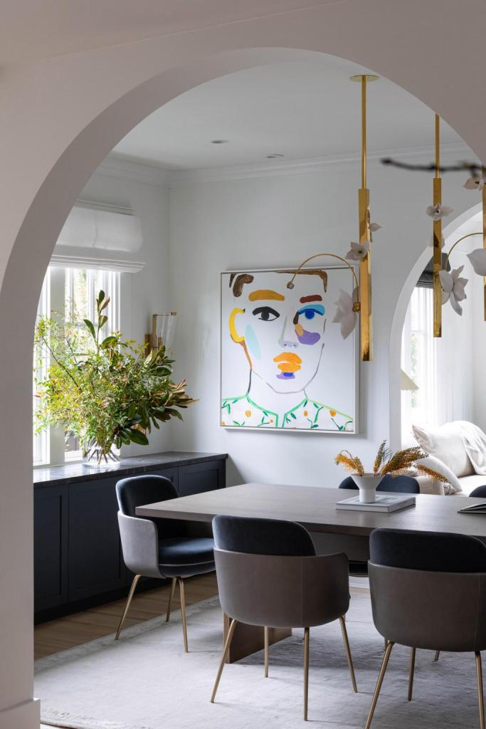 a modern dining room with art and cool lighting