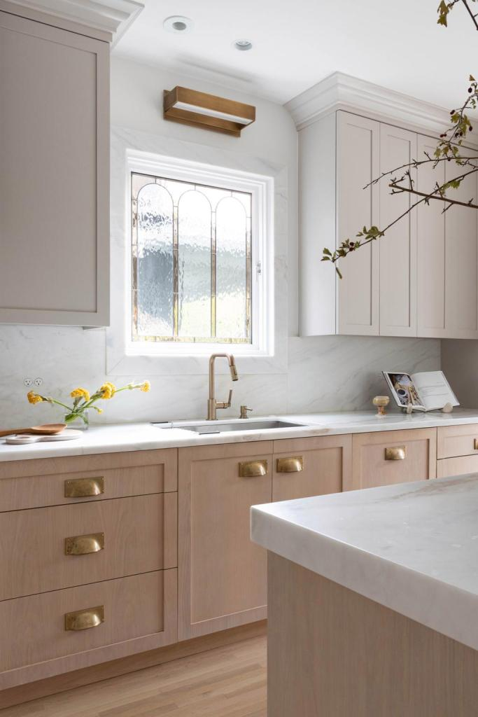 a modern kitchen with wood cabinetry