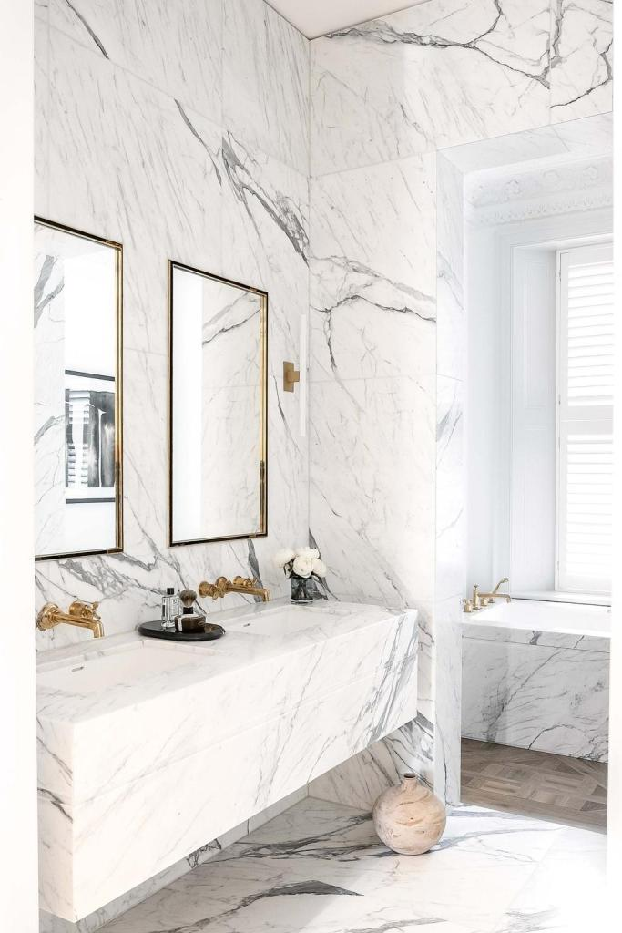 The all-marble wrapped walls, flooring and the floating vanity in this master bath