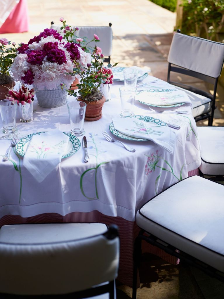 elegant outdoor tablescape with emboidered tablecloth