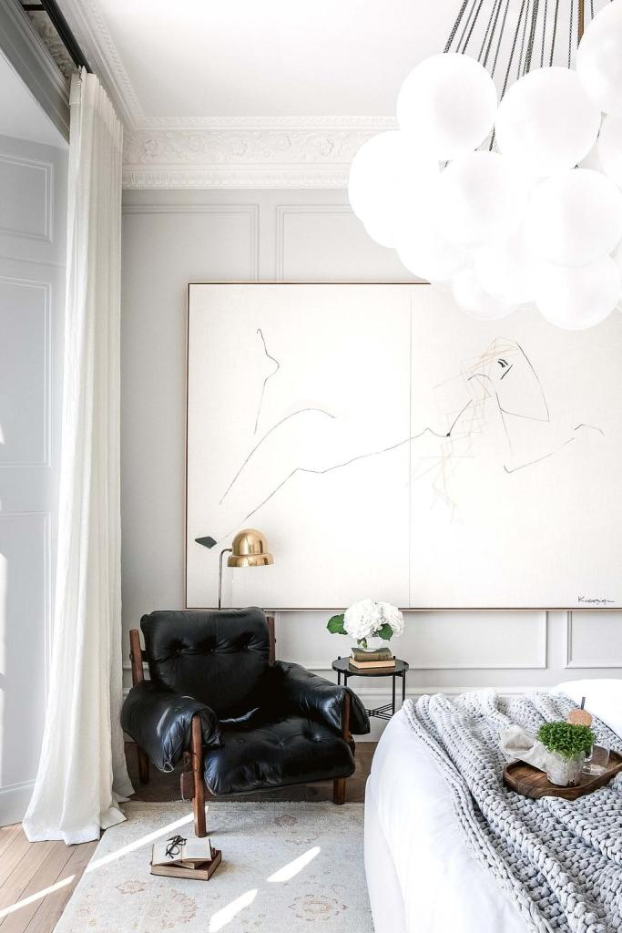 The linen, leather and wool create such a relaxing casual elegance in this all-white bedroom.