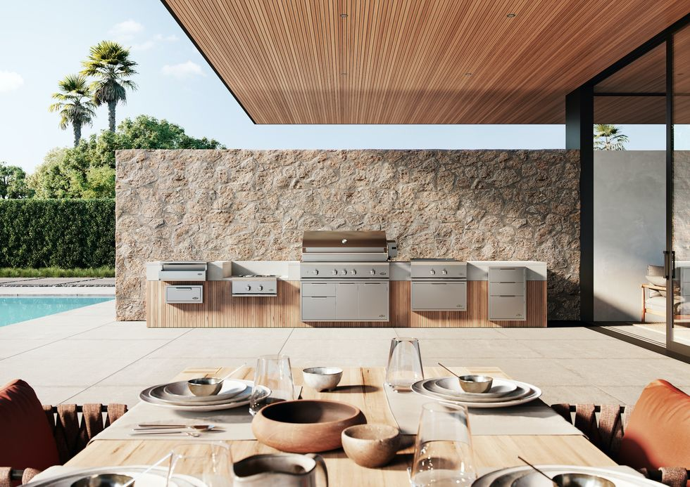 the modern outdoor appliances pair with the organic earthy clay tableware