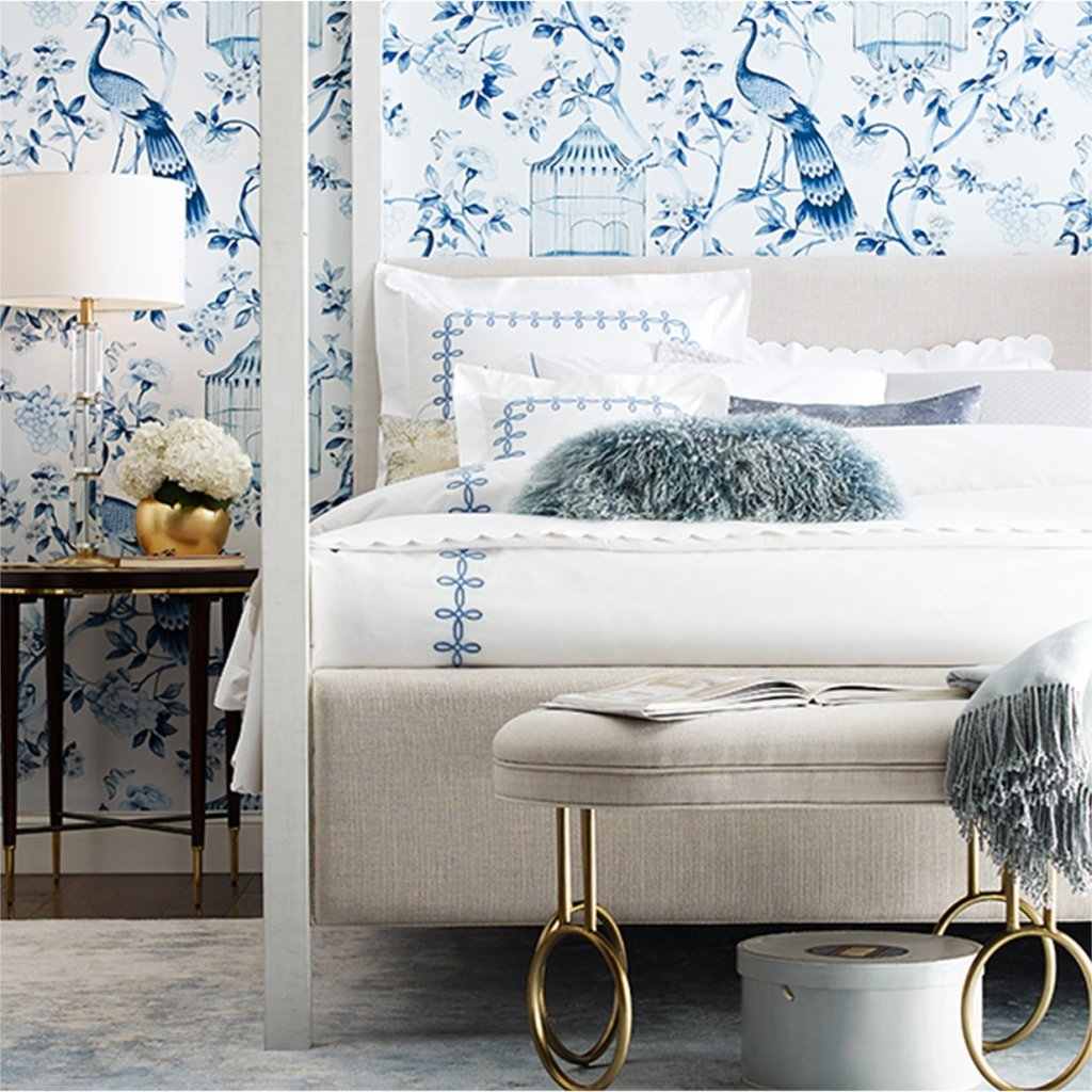 blue chinoiserie wallpaper in a classic bedroom