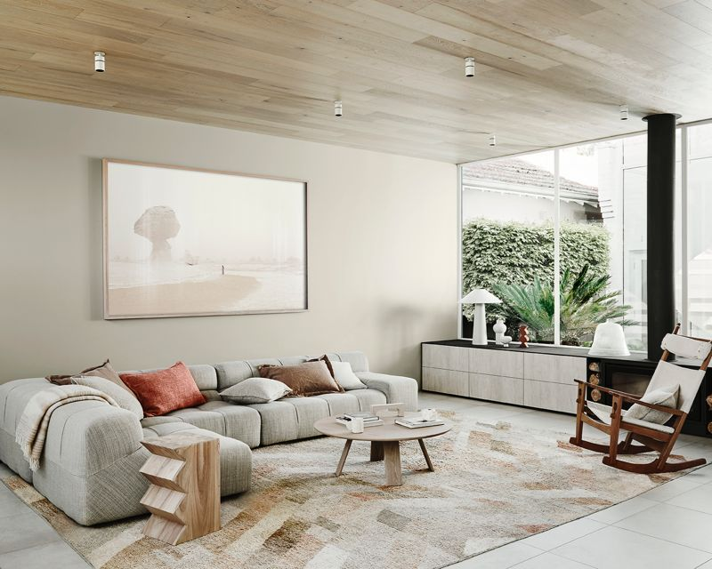 The neutral color schemes with subtle pops of color on accessories and artwork create a calming and layered interior.