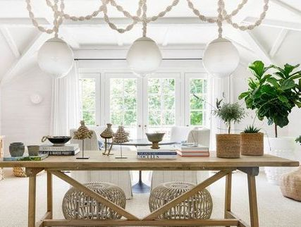 oversized natural-fiber chanderlier in this airy living room