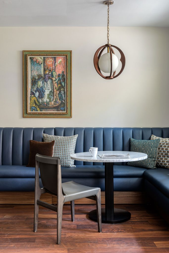 build-in channeled dark blue banquette gives the kitchen a chic cafe vibe