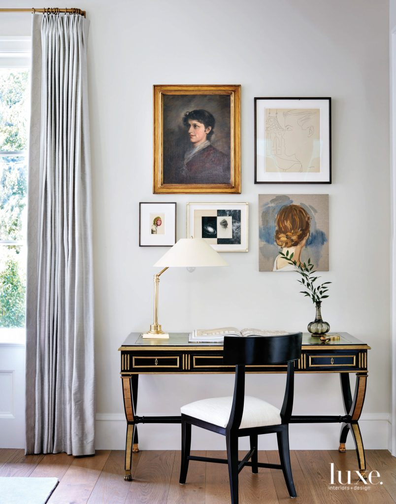 The well curated artwork on the wall with a gilded writing desk creates such an elegant vignette.