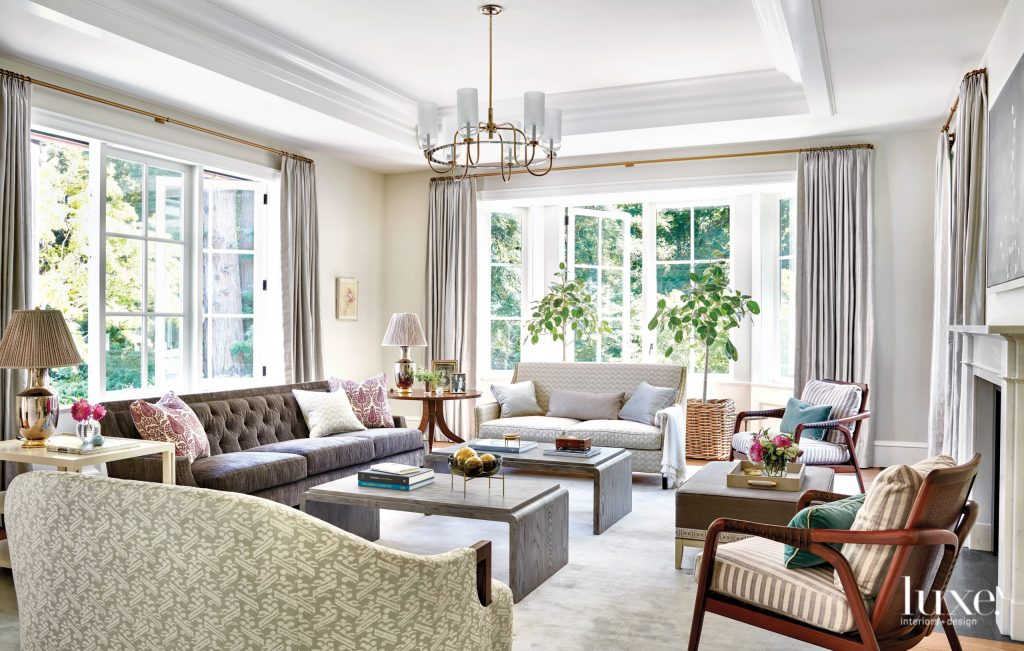 The seating area in the light-filled living room is  open, warm, inviting and perfect for family or friends getting together.