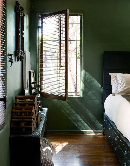 The country-feel bedroom features color of green