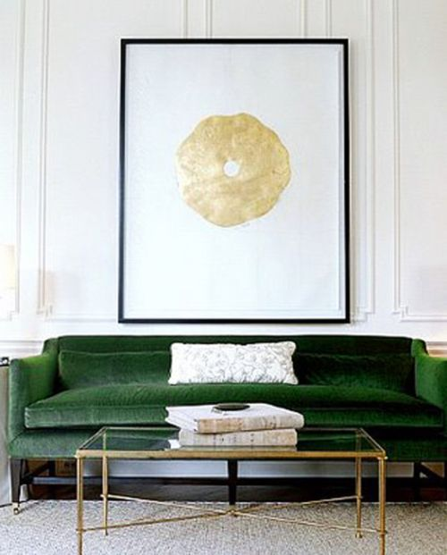 Clean-lined green sofa with a classical form
