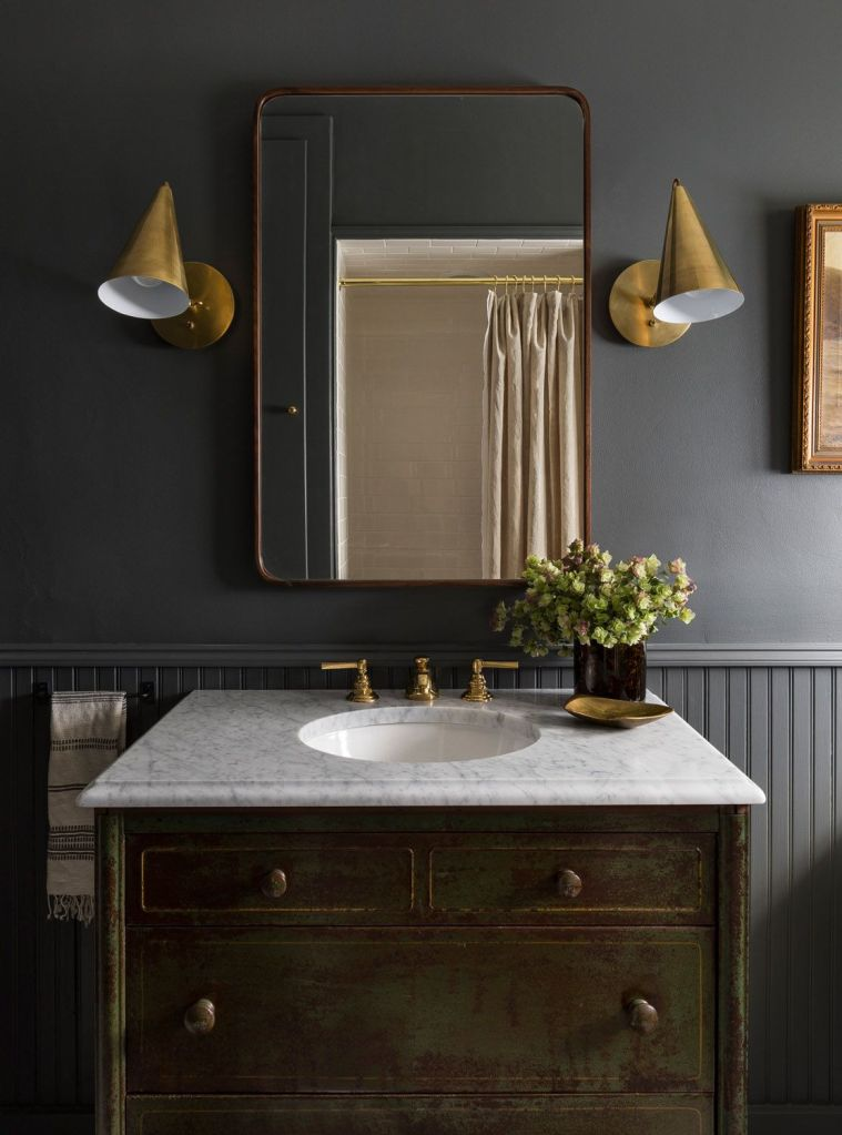 Rustic yet sophiticated powder room with a modern farm house green vanity
