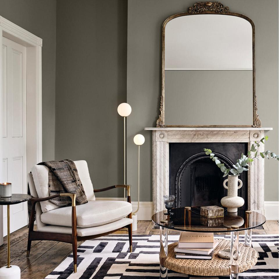 antique mirror over the fireplace has an old-world charm to make this conversational zone interseting