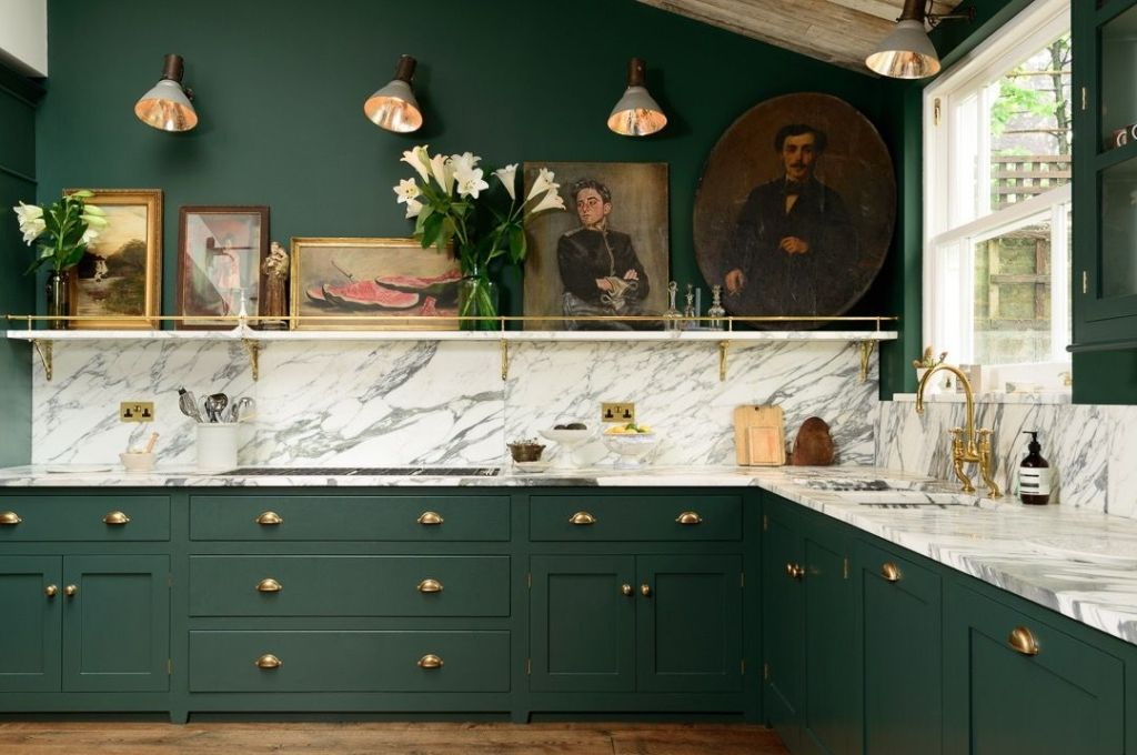 Muted green cabinetry , creamy marble countertops & backsplash and brass hardware