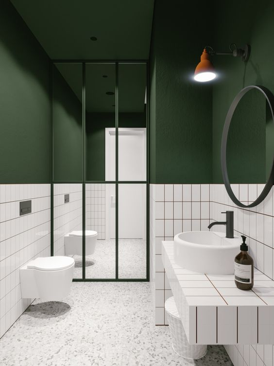 A modern bathroom featuring the color of green and crisp white