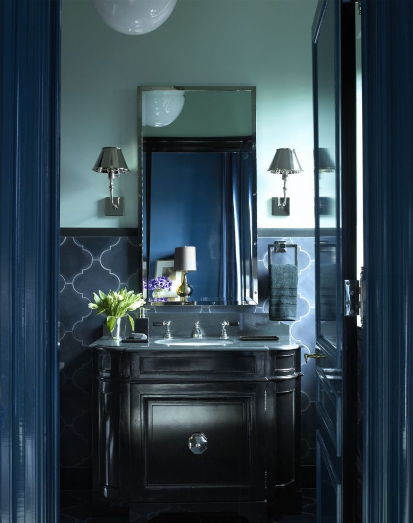 A Moody Moment With Dark Hues In The Powder Room