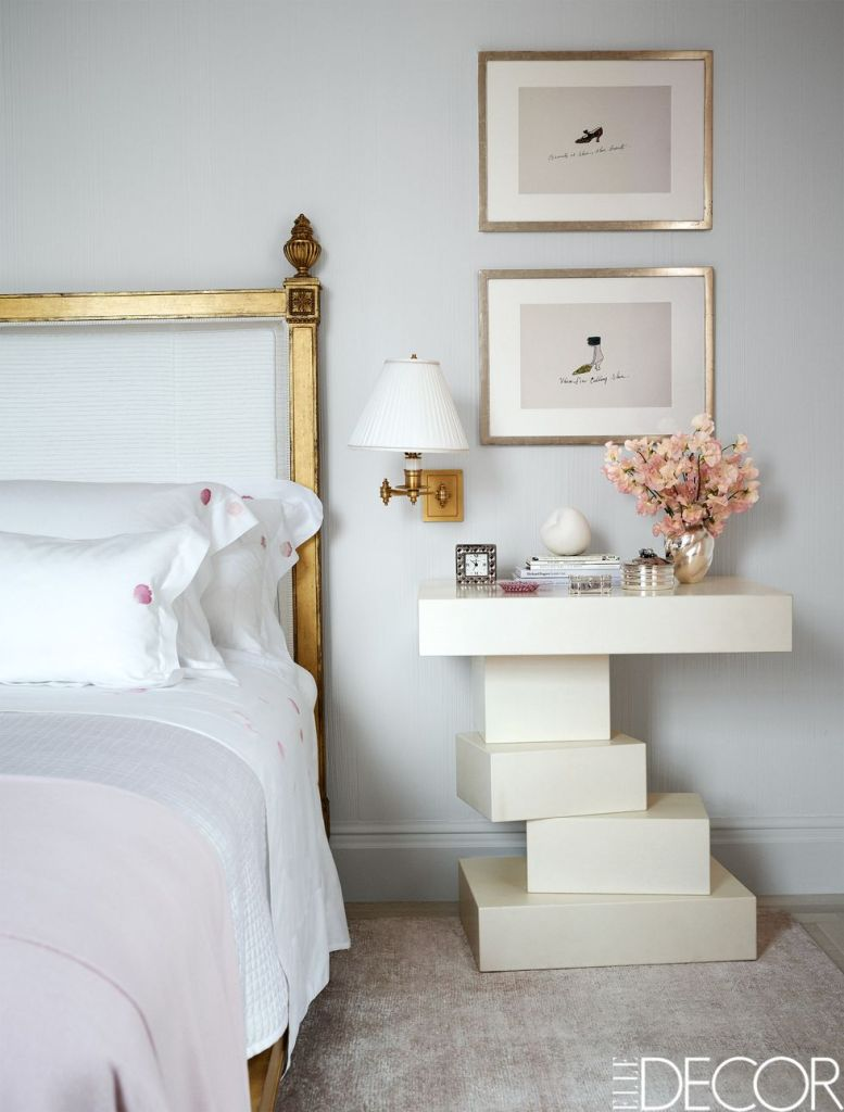 brass-detailed classical bed frame and modern white nightstand