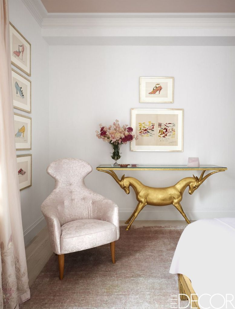 blush tufted lounge chair and deer console