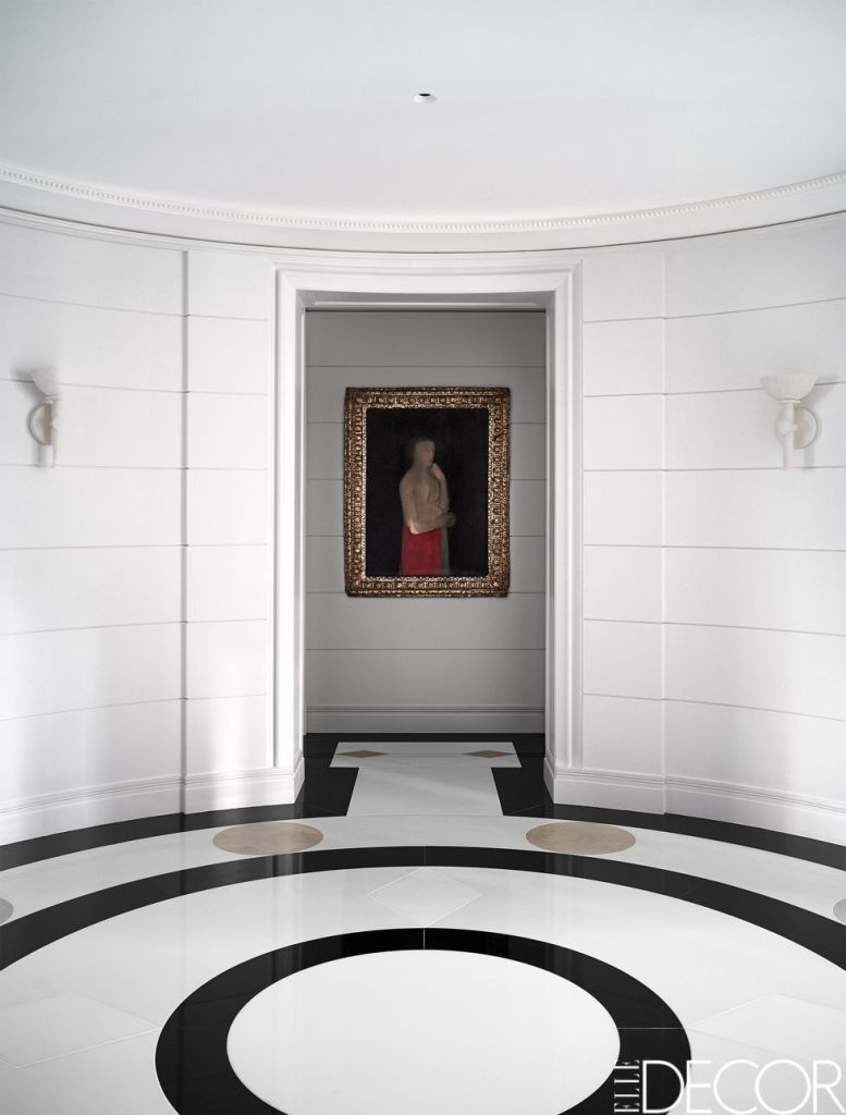 glam entry with white walls and white marble flooring