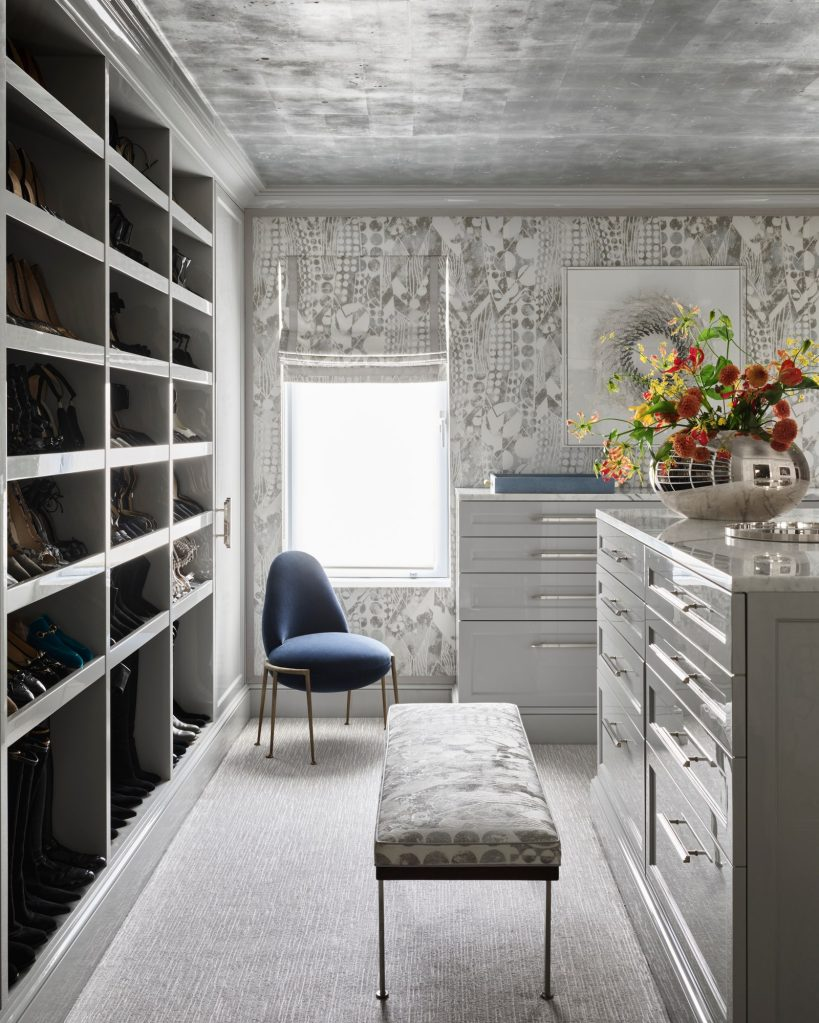 a chic closet with shimmering silver-leaf ceiling