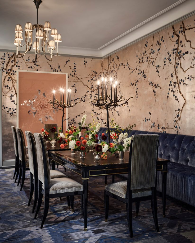 glam dining room  wrapped with shimmery hand-painted chinoiserie wallpaper blossoms