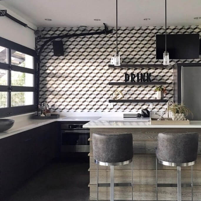 geometric to-the-ceiling tiling wall