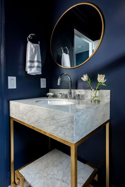 Nice contrast between the light color on the vanity marble and dark blue on the walls