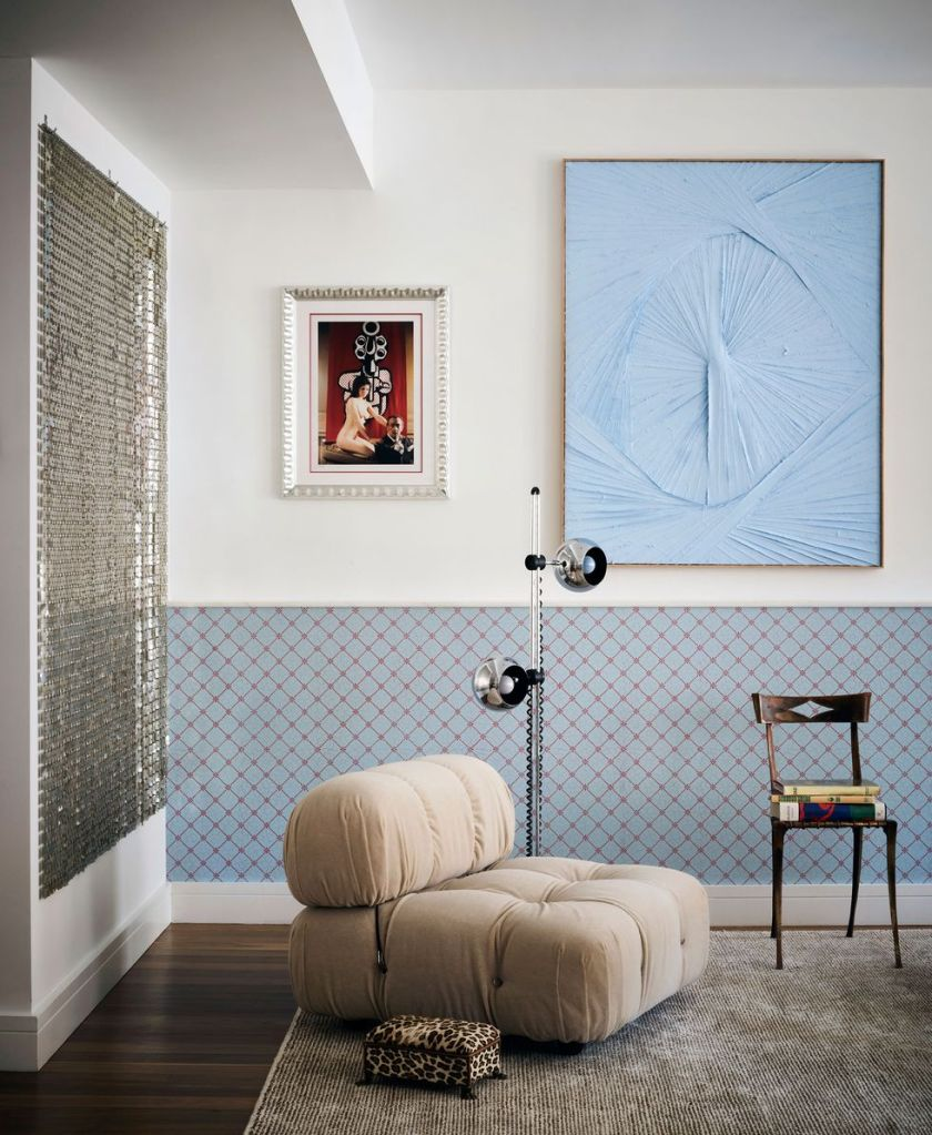mix of traditional wallpaper and modern Italian chair