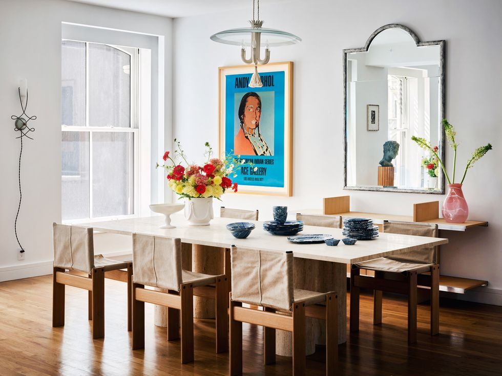 modern and traditional dining room features art