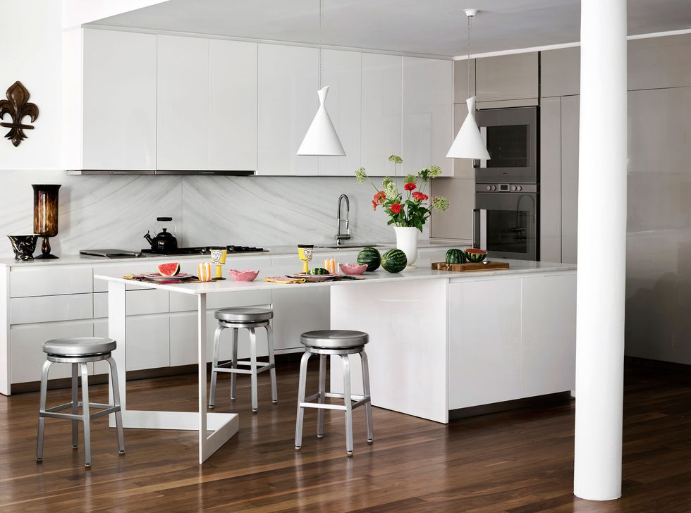 a all-white modern kitchen with beautiful tablescape