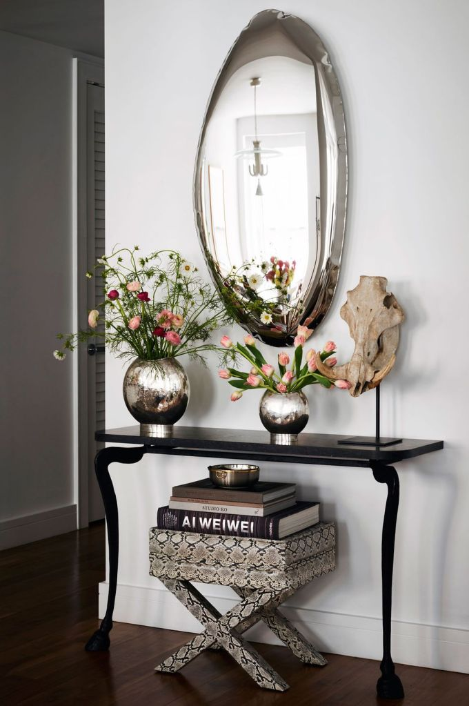 A whimsical foyer with vintage pieces
